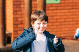 Smiling Boy on Playground