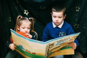 Two Children Reading Big Book