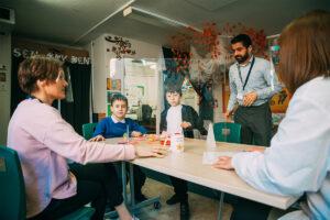 Hearing Unit Children and Teachers Around Table