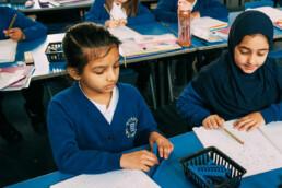 Two Children Working at Desk