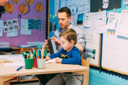 Teacher and Boy at Table